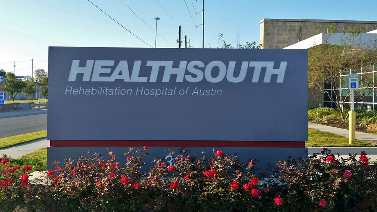 Repair of Healthsouth sign in Austin, Texas